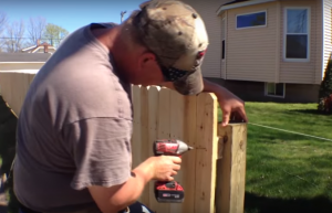 installing wooden fence