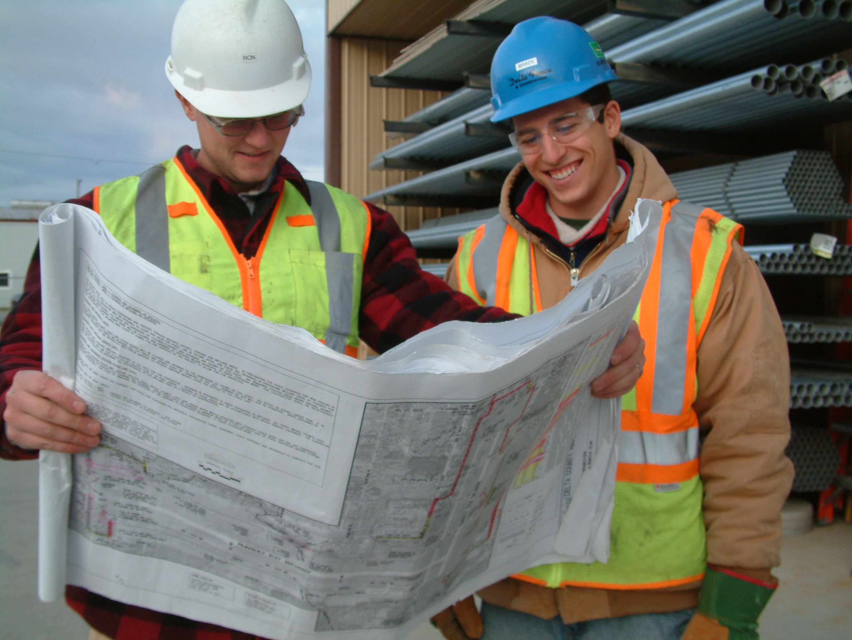 Man on Construction Studying Blueprint